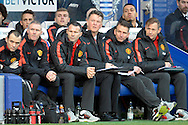 Manchester United Manager Louis van Gaal and his coaching team watch on from the dugout. Barclays Premier league match, Queens Park Rangers v Manchester Utd at Loftus Road in London on Saturday 17th Jan 2015. pic by John Patrick Fletcher, Andrew Orchard sports photography.