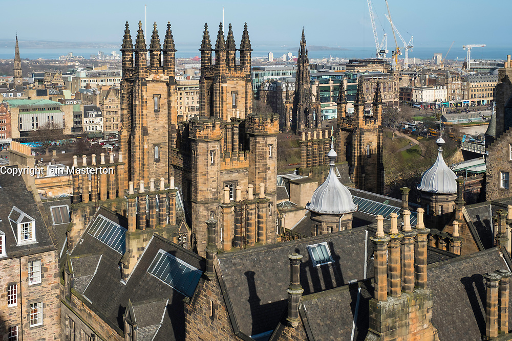 View over spires and towers of New College , part of Edinburgh University , on The Mound in  Edinburgh, Scotland, United Kingdom.