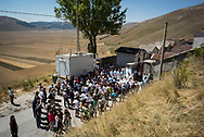 A mass is held by the cimitery. The church has collapsed during the earth quake and about ten month after the event villagers have been able to organize a mass and a religius procession to celebrate the patron saint