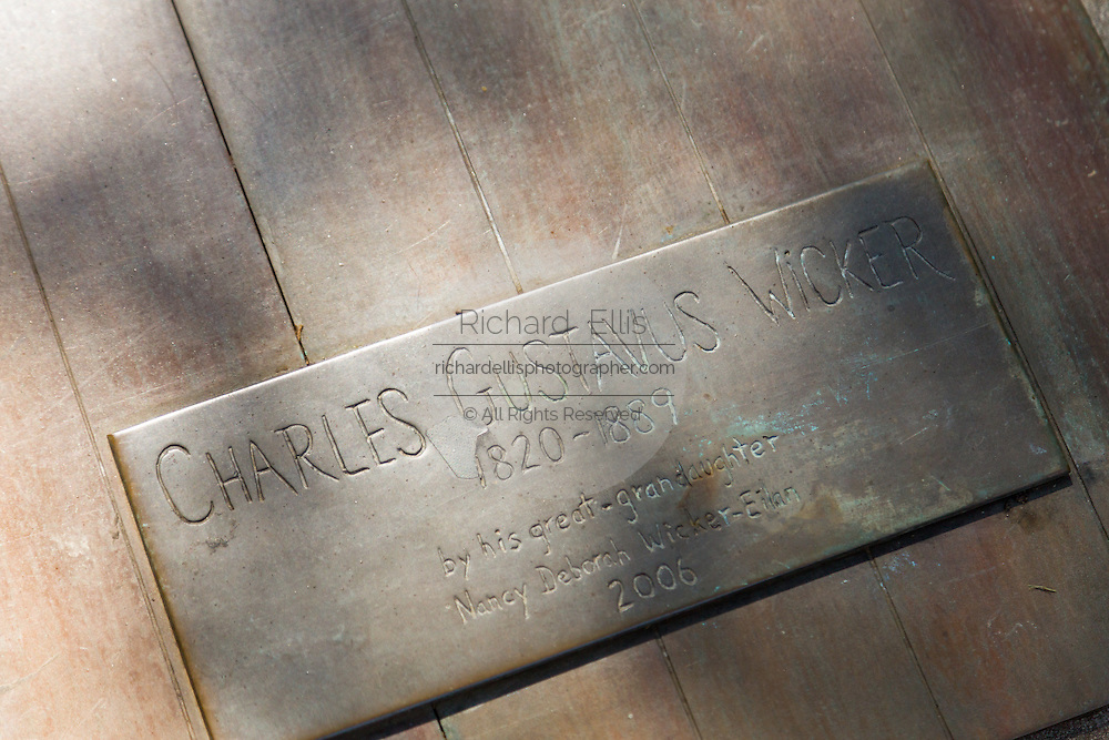 Engraved brass marker honoring Charles Gustavus Wicker founder of the Wicker Park neighborhood in the West Town community in Chicago, Illinois, USA