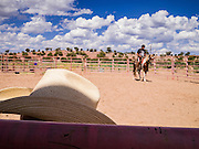 """13 JULY 2012 - FT DEFIANCE, AZ:  A horsemanship clinic at the 23rd annual Navajo Nation Camp Meeting in Ft. Defiance, north of Window Rock, AZ, on the Navajo reservation. In addition to preaching and prayer, there are classes on horsemanship at the camp meeting. Preachers from across the Navajo Nation, and the western US, come to Navajo Nation Camp Meeting to preach an evangelical form of Christianity. Evangelical Christians make up a growing part of the reservation - there are now more than a hundred camp meetings and tent revivals on the reservation every year. The camp meeting in Ft. Defiance draws nearly 200 people each night of its six day run. Many of the attendees convert to evangelical Christianity from traditional Navajo beliefs, Catholicism or Mormonism. """"Camp meetings"""" are a form of Protestant Christian religious services originating in Britain and once common in rural parts of the United States. People would travel a great distance to a particular site to camp out, listen to itinerant preachers, and pray. This suited the rural life, before cars and highways were common, because rural areas often lacked traditional churches.   PHOTO BY JACK KURTZ"""