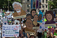 David Suzuki and other scientists held up on signs during the Climate March.