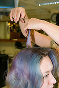 A hairdresser cutting a womans hair