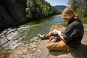 Conservation student Blakely Adkins records field notes during a summer program run by Round River Conservation Studies in the Taku River watershed of Northern Canada.