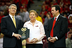 """31 January 2009: Missouri Valley Commissioner Doug Elgin presents Molly Arnold with the conferences Most Courageous Award.  Illinois State Athletic Director Sheahon Zenger stands on Molly's left.  Molly battle cancer. The Illinois State University Redbirds join the Bradley Braves in a tie for 2nd place in """"The Valley"""" with a 69-65 win on Doug Collins Court inside Redbird Arena on the campus of Illinois State University in Normal Illinois"""