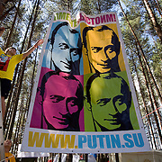 "Pro-Putin Nashi youths hang a poster of Russian Prime Minister Vladimir Putin at a summer camp on Lake Seliger in Russia. The headline reads: ""Together we will stand our ground!"" The domain name .su refers to ""Soviet Union"". Putin has called the collapse of the Soviet Union the greatest geo-political disaster of the 21st century. .This yearly camp, organised by the nationalistic group, trains youth in political activism."