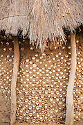 Old tin cans are used as sustainable building materials in the village of Seronga in the Okavango Delta, Botswana