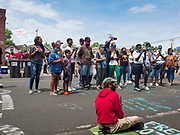 """12 JUNE 2020 - MINNEAPOLIS, MINNESOTA: People at the impromptu community memorial for George Floyd at the corner of 38th Street and Chicago Ave. in Minneapolis. The intersection is informally known as """"George Floyd Square"""" and is considered a """"police free zone."""" There are memorials to honor Black people killed by police and people providing free food at the intersection. Floyd, an unarmed Black man, was killed by Minneapolis police on May 25 when an officer kneeled on his neck for 8 minutes and 46 seconds. Floyd's death sparked weeks of ongoing protests and uprisings against police violence around the world.          PHOTO BY JACK KURTZ"""