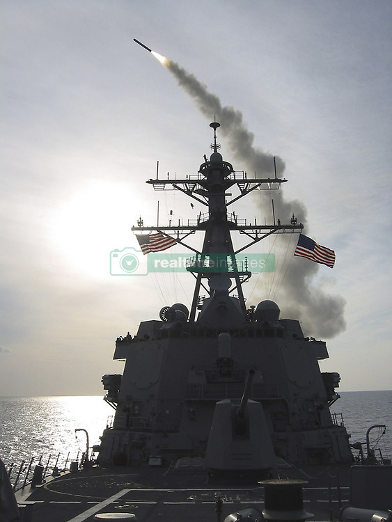 April 6, 2017 - *FILE PHOTO* - President Trump ordered a massive military strike on a Syrian air base in retaliation for a 'barbaric' chemical attack he blamed on Syria's President. Navy gun ships USS Porter and USS Ross targeted Shayrat Airfield in Syria, where planes that carried out the chemical attack where launched from. Pictured: March 24, 2003 - File pic. A TOMAHAWK CRUISE MISSILE launches from USS WINSTON S. CHURCHILL (DDG 81) March 23, 2003. CHURCHILL operated in the eastern Mediterranean Sea in support of Operation Iraqi Freedom. The USA and UK are currently considering military action in Syria following reports of chemical weapons being used on civilians (Credit Image: © U.S. Navy/ZUMA Wire/ZUMAPRESS.com)