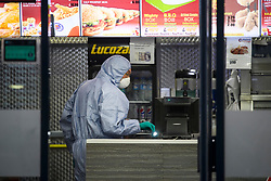 © Licensed to London News Pictures. 21/08/2018. London, UK. Police forensics at Chicken Cottage on Rayners Lane, Harrow, north London, the scene of a double shooting. Armed police are reported to be searching the area after two men were shot in broad daylight. Their condition is unknown. This follows two separate shooting incidents in London yesterday. Photo credit: Ben Cawthra/LNP