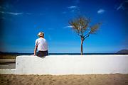 son serra de Marina, Mallorca, Woman looking at the horizon on the coastline. 16-08-2018