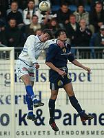 Drammen 130403 - Strømsgodset - Hødd 1-1 Marinlyst stadion. Kenneth Karlsen, Strømsgodset i hodeduell med Høddspiller.<br /> <br /> Foto: Andreas Fadum, Digitalsport