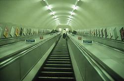 Escalator in tube station; London,