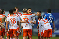 Football - 2020 / 2021 Sky Bet League One - Portsmouth vs. Blackpool - Fratton Park<br /> <br /> Kenny Dougall of Blackpool hugs goalscorer Jerry Yates of Blackpool at Fratton Park <br /> <br /> COLORSPORT/SHAUN BOGGUST