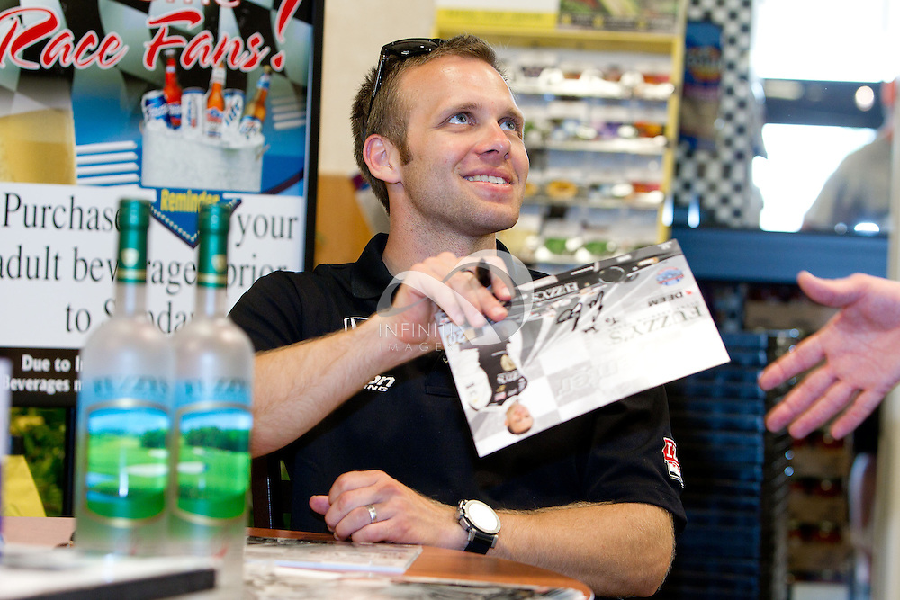 Fuzzy's Vodka driver Ed Carpenter of the IZOD IndyCar Series signs autographs at Kroger in Indianapolis, Indiana. Corporate event photography by Infiniti Images