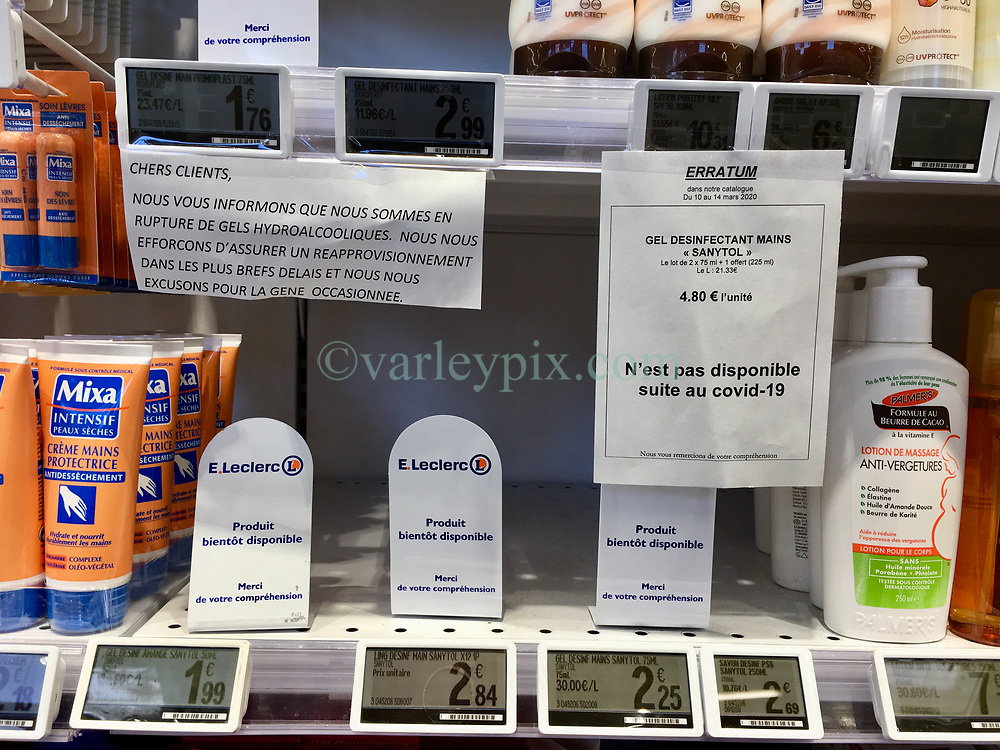 23 March 2020. Montreuil Sur Mer, Pas de Calais, France. <br /> Coronavirus - COVID-19 in Northern France.<br /> <br /> Shelves stripped of hand sanitizer at Leclerc supermarket in Attin near Montreuil Sur Mer. Hand sanitiser was one of the first items to disappear from supermarket shelves.<br /> <br /> Numbers entering the store at any one time are restricted to try and maintain 'social distancing,' in an effort to halt the spread of the virus. Anyone leaving their home must carry with them an 'attestation,' in a effect a self administered permit to allow them out of the house. If stopped by the police, one must produce a valid permit along with identification papers. Failure to do so is punishable with heavy fines. Movement in France has been heavily restricted by the government.<br /> <br /> Montreuil Sur Mer was the headquarters of the British Army under Field-Marshal Sir Douglas Haig from March 1916 to April 1919. Over 1,200 year old, the ancient fortified  town with its high ramparts has endured through history, surviving the plague and King Henry VIII's invasion of France in 1544 when the Duke of Norfolk under Henry VIII's command laid a disastrous siege to the town which held firm until Norfolk was forced to withdraw in 1545. Residents are confident the ancient town can survive the coronavirus too. <br /> Photo©; Charlie Varley/varleypix.com