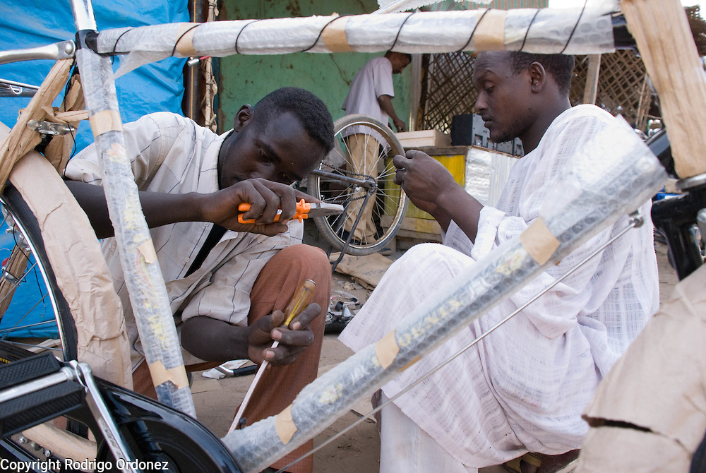 Activity at a bike repair shop in the market of Abyei.