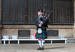 Piper David Johnston-Graham, a LNER train manager, plays the pipes at Waverley Station, at 3pm. This was time that Winston Churchill announced on the radio that the war in Europe had come to an end, following Germany's surrender the day before.