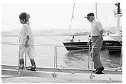 Elizabeth Taylor and Malcolm Forbes walking the plank to Rupert Murdoch's yacht in Tangier harbour. . Malcolm Forbes birthday party. Tangier. 1989.© Copyright Photograph by Dafydd Jones 66 Stockwell Park Rd. London SW9 0DA Tel 020 7733 0108 www.dafjones.com
