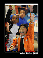 Rajena Gurung ,6, raises her hands to answer a math question inside a kindergarten class at the International Community School on Friday, Dec 17, 2010. She is from Nepal. Metro Atlanta continues to draw new foreign born residents, despite the economic downturn - which sets it apart from many other metro regions around the country.  © 2010 Johnny Crawford