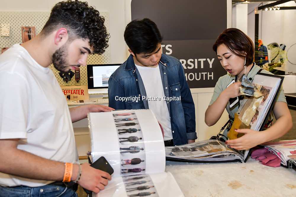 Attendees at the Graduate Fashion Week 2019 - Day One Exhibitions on 2 June 2019, London, UK.