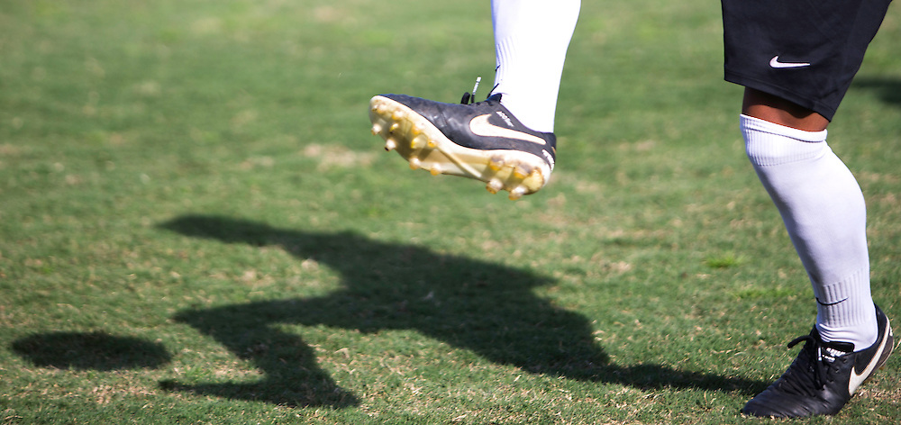 A Golden West soccer player plays with his shadow during his teams 2-0 win over over Fullerton College on November 4, 2016.