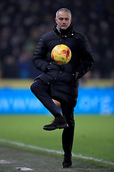 Manchester United manager Jose Mourinho controls the ball on the touchline