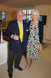 VISCOUNT & VISCOUNTESS NORWICH at a party to celebrate the publication of Diana by Sarah Bradford held at 80 The Strand, London on 27th September 2006.<br />