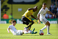 Ki Sung-Yueng of Swansea City fouls Odion Ighalo of Watford. Barclays Premier League, Watford v Swansea city at Vicarage Road in London on Saturday 12th September 2015.<br /> pic by John Patrick Fletcher, Andrew Orchard sports photography.