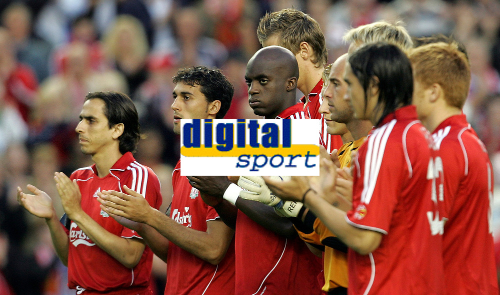Photo: Paul Thomas.<br /> Liverpool v Toulouse. UEFA Champions League Qualifying. 28/08/2007.<br /> <br /> Liverpool players clap before the match tonight in memory of Everton support Rhys Jones, who was mudered last week.