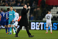 Paul Clement, the Swansea city manager celebrates on the pitch at the end of the match after his teams 2-0 win. Premier league match, Swansea city v Leicester City at the Liberty Stadium in Swansea, South Wales on Sunday 12th February 2017.<br /> pic by Andrew Orchard, Andrew Orchard sports photography.