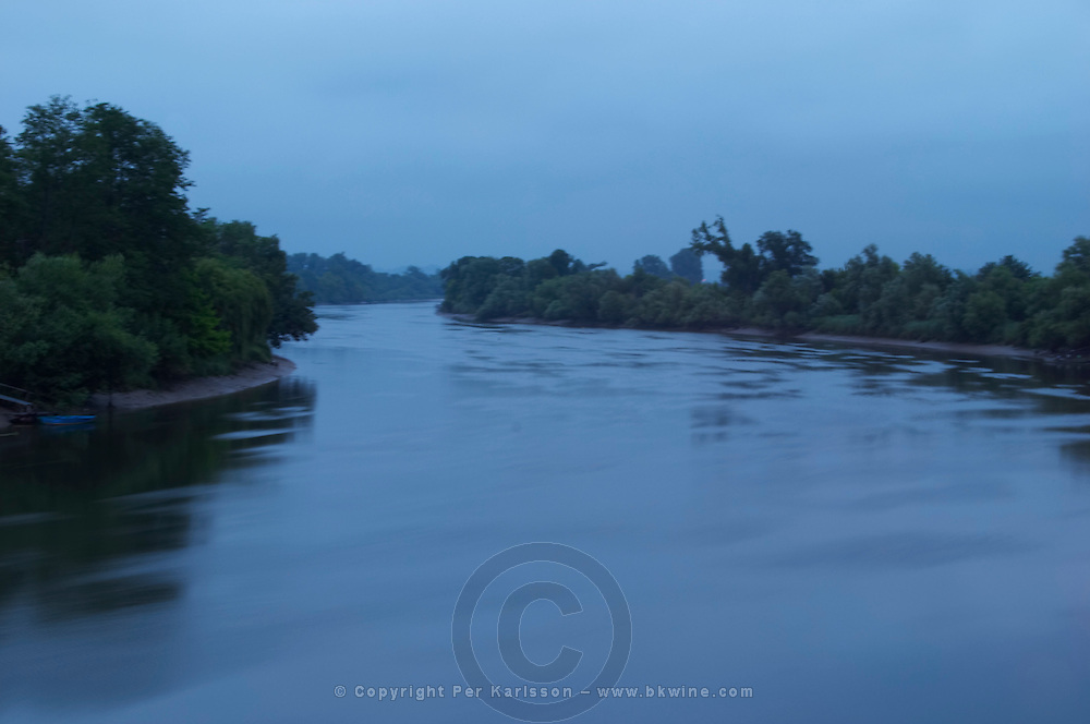 A view over the river Dordogne with at night fall during the blue hour heure bleu with rain, Branne Entre-deux-Mers Bordeaux Gironde Aquitaine France