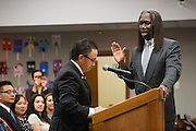 Newly elected Board member Chris Norwood, right, is sworn into office by Pastor Randy Estrada during the Milpitas Unified School District Board of Education Administration of the Oath of Office ceremony at the Board of Education in Milpitas, California, on December 9, 2014. (Stan Olszewski/SOSKIphoto)