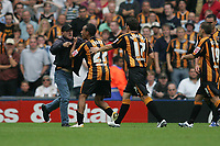 Photo: Lee Earle.<br /> West Bromwich Albion v Hull City. Coca Cola Championship. 05/08/2006. A Hull supporter runs onto the pitch showing his anger at towards his team.