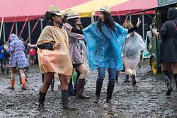 © Licensed to London News Pictures . 07/06/2014 . Heaton Park , Manchester , UK . Revellers traipse through mud . The Parklife music festival in Heaton Park Manchester following heavy overnight rain . Photo credit : Joel Goodman/LNP