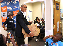 "President Barack Obama surprises workers at the ""Obama For America"" Orlando field office with a stack of pizzas during an unannounced visit in Orlando, Florida, USA, Sunday, October 28, 2012. Photp by Joe Burbank/Orlando Sentinel/MCT/ABACAPRESS.COM  