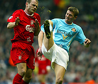 Liverpool's Danny Murphy gets kicked in the head by Sunderland's Tore Andre Flo during the Premiership match at Anfield, Liverpool, Sunday, November 17th, 2002. <br /><br />Pic by David Rawcliffe/Propaganda<br /><br />Any problems call David Rawcliffe on +44(0)7973 14 2020 or email david@propaganda-photo.com - http://www.propaganda-photo.com