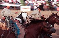 Cowboys riding horses at Fort Qu'Appelle Rodeo, Saskatchewan