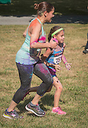 Monroe, New York - People compete in the South Orange Family YMCA 5K Color Run & Kids Color Dash on July 16, 2016.