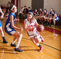 Laconia freshman Erika Marchione maneuvers around Franklin junior Kelsey Bird, on her way to the bucket, during Tuesday's game at Laconia High School.  (Alan MacRae/for the Laconia Daily Sun)