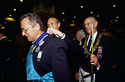 Freemasons assemble in their regalia at Earls Court for a public display. Freemasonry, which traces it's modern origins back to the sixteenth century is beased on principles of fraternity and secrecy. Members are sworn to keep silent on their activities and make themselves known to other Freemason's by way of signal (often a handshake).