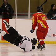 Regan Wilson, New Zealand falls to the ice after a collision during the China V New Zealand match during the 2012 IIHF Ice Hockey World Championships Division 3 held at Dunedin Ice Stadium. Dunedin, Otago, New Zealand. 21st January 2012. Photo Tim Clayton