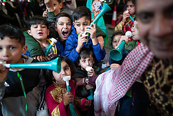 © Licensed to London News Pictures. 05/06/2019. Manchester, UK. Children play noisily with vuvuzelas . People celebrate Eid-ul-Fitr , the end of a month of fasting during Ramadan , in Rusholme in Manchester . Photo credit: Joel Goodman/LNP