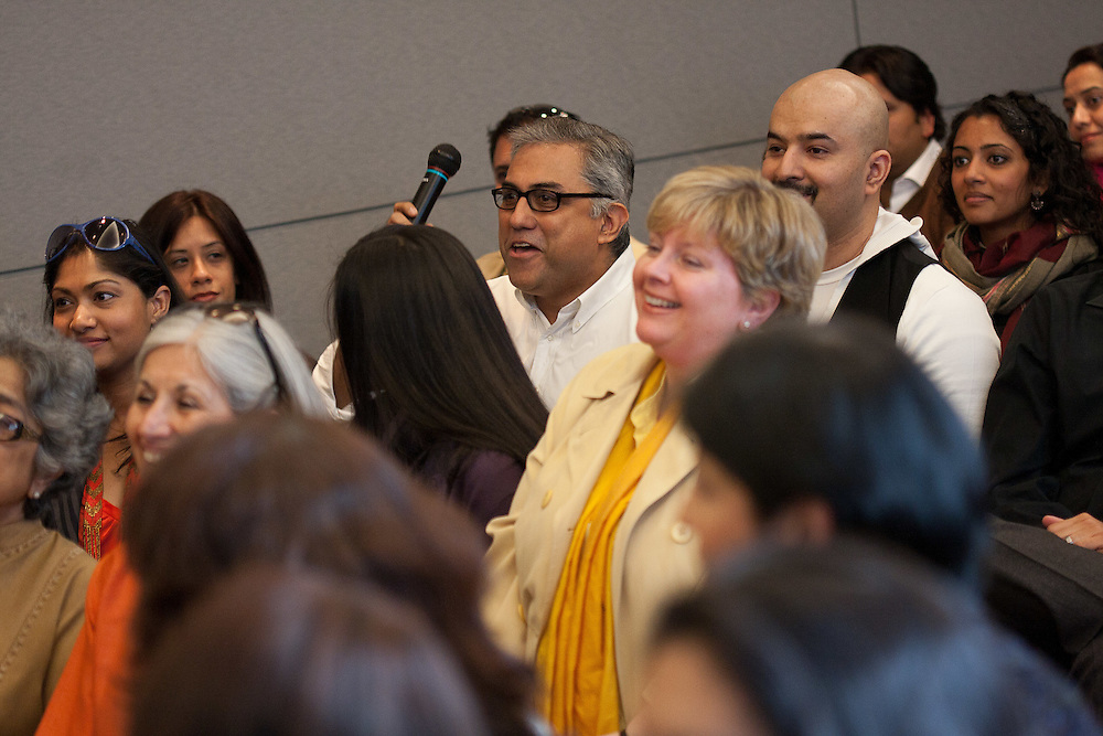 Aseem Chhabra (with microphone) at a forum with Academy Award-winning composer AR Rahman at the Asia Society