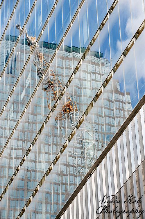 Reflection of a crane in a skyscraper window, Ground Zero, NYC, USA