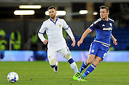 Cardiff City's Joe Ralls (r) passes past Leeds player Mirco Antenucci. Skybet football league championship match, Cardiff city v Leeds Utd at the Cardiff city stadium in Cardiff, South Wales on Tuesday 8th March 2016.<br /> pic by Carl Robertson, Andrew Orchard sports photography.