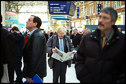 London Mayor Boris Johnson at Waterloo Station on his way to Campaign in Feltham, West London, for the By-Election with Mark Bowen the Conservative Party Candidate, Tuesday December 13, 2011 Photo By Andrew Parsons/ i-Images