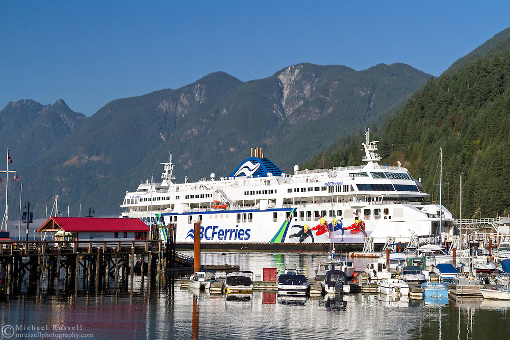 The BC Ferries' Coastal Renaissance comes in to dock at Horseshoe Bay Ferry Terminal on a return trip from Nanaimo.  Photographed from Horseshoe Bay Park in Horseshoe Bay, British Columbia, Canada.