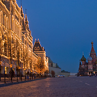 Moscow, Russia. Lighted stores at Red Square. St. Basil's Cathedral background.