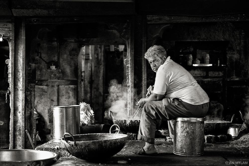 A man cooks street food in Jodhpur, Rajasthan, India